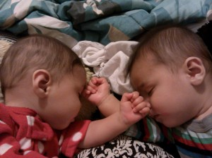 twins fight asleep